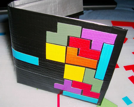 KMC Designs has now made a Tetris style version. The tetris duct tape wallet
