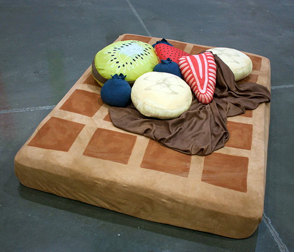 Waffle Bed with Syrup Sheets and Fruit Pillows